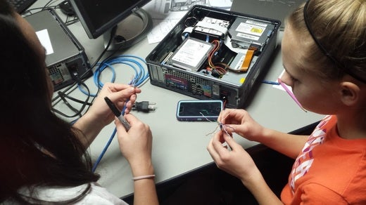 Students crimping their own Ethernet cables.