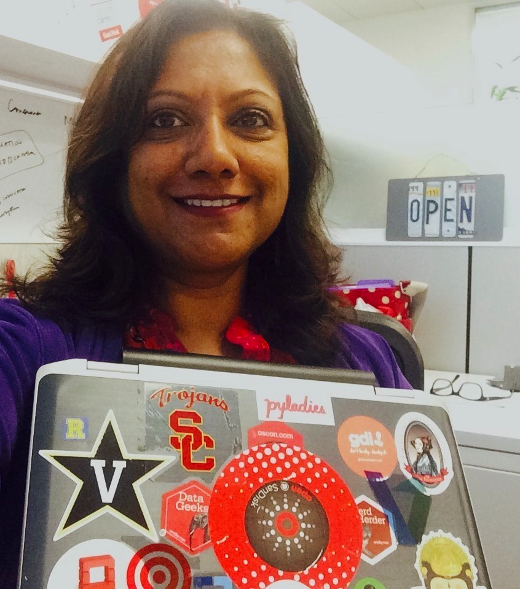 Nithya with her laptop