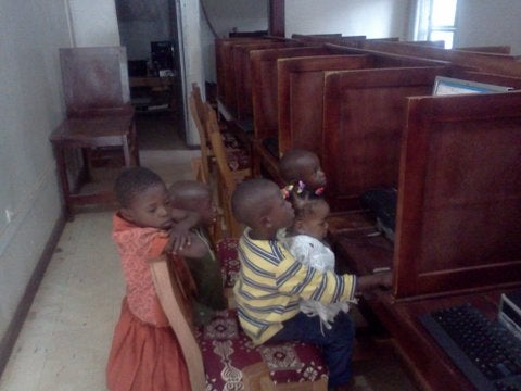 Children at the cybercafe in Cameroon