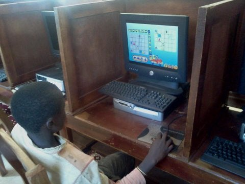 Child using Peppermint OS in Cameroon