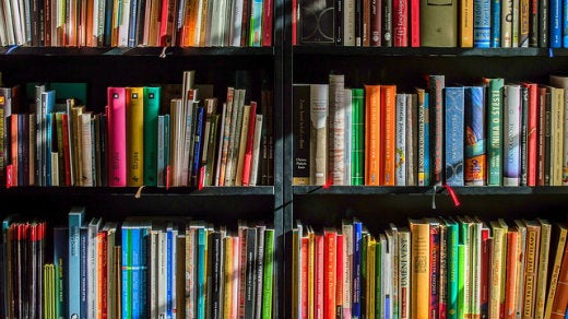 books on shelves in a library, colorful