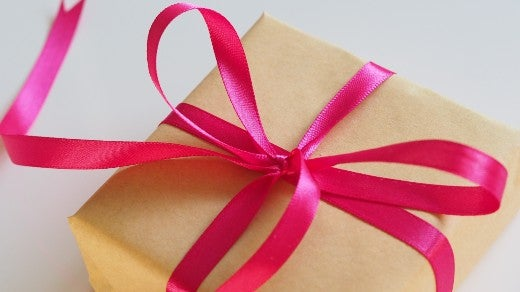 Package wrapped with brown paper and red bow