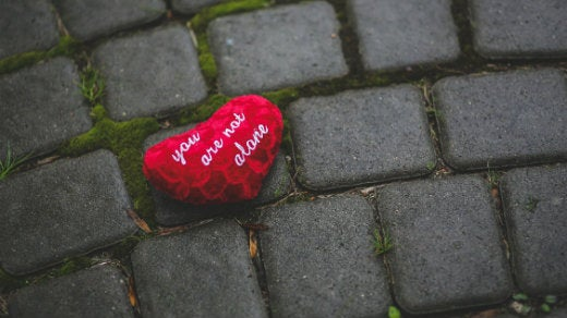 """Red heart with text """"you are not alone"""""""