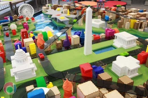 a scale model, artistic interpretation of the future of Washington, DC, featuring 3D printed buildings and vehicles