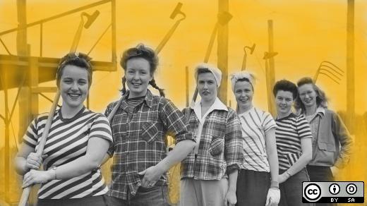 six women holding tools