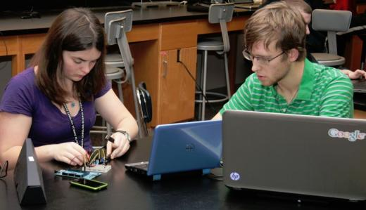 Two students working with Arduino in science class