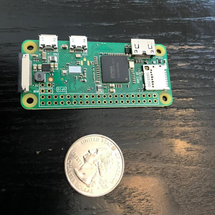 Raspberry Pi Zero's size compared to a quarter
