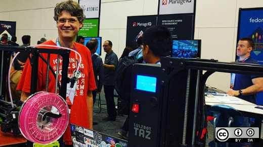 2016 Red Hat Summit booth with Tom Callaway and a Lulzbot TAZ 3D printer