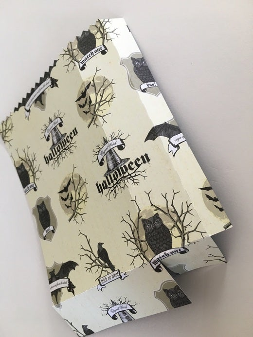 Paper with bats, owls, and Halloween banners