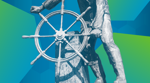 A ship wheel with someone steering