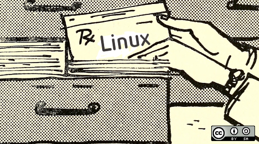 Hand putting a Linux file folder into a drawer