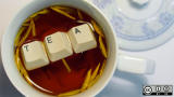 keyboard keys, tea in cup of tea