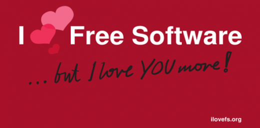 Red postcard that says I heart free software, but I love you more!