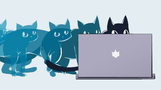Cats behind a laptop