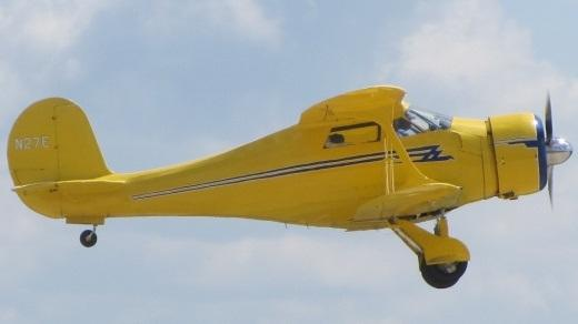 Yellow plane flying in the air, Beechcraft D17S