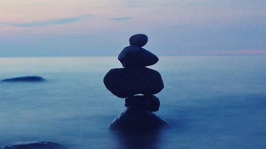 Stack of rocks in blue mist