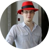 A man in a red hat signifying the Opensource company called Red Hat
