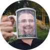 Crazy-looking guy drinking his own head from a coffee cup