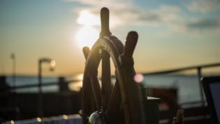 Boat helm at sunset for navigation