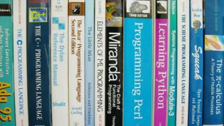 Programming books on a shelf
