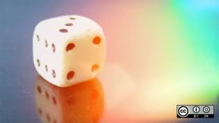 A die with rainbow color background