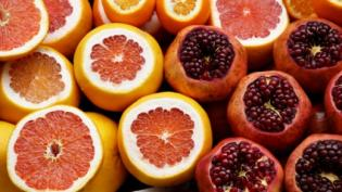 Cut pieces of citrus fruit and pomegranates