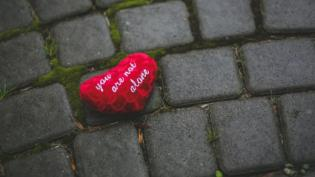 "Red heart with text ""you are not alone"""