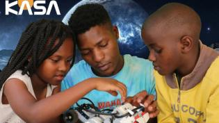 Youth working with a robot program