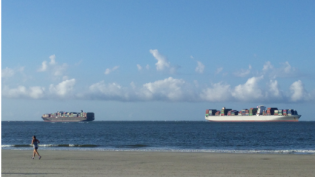 two ships passing in the ocean