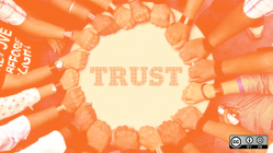 Hands together around the word trust