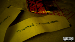 "A fortune cookie that says ""to succeed, you must share"""