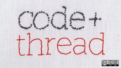 Code and thread written in embroidery