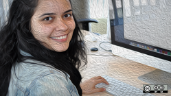 Women smiling from her computer screen