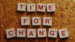 "scrabble letters: ""time for change"""
