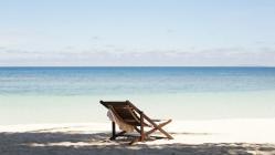 One chair on a sandy beach