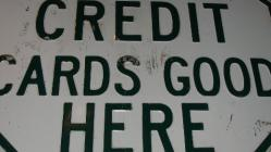 sign that says credit cards good here