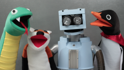 Puppets: a penguin, a snake, a robot, and a fox