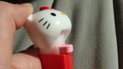 Hello kitty pez dispenser with hand and candy