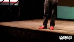 Jim Whitehurst wears his red shoes on stage at All Things Open 2015