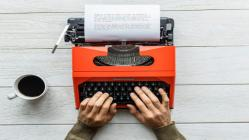 Typewriter with hands