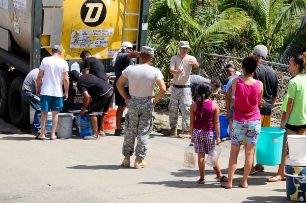 Puerto Rico National Guard soldiers distributing water in San Jose