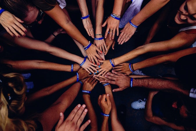Many hands in a circle