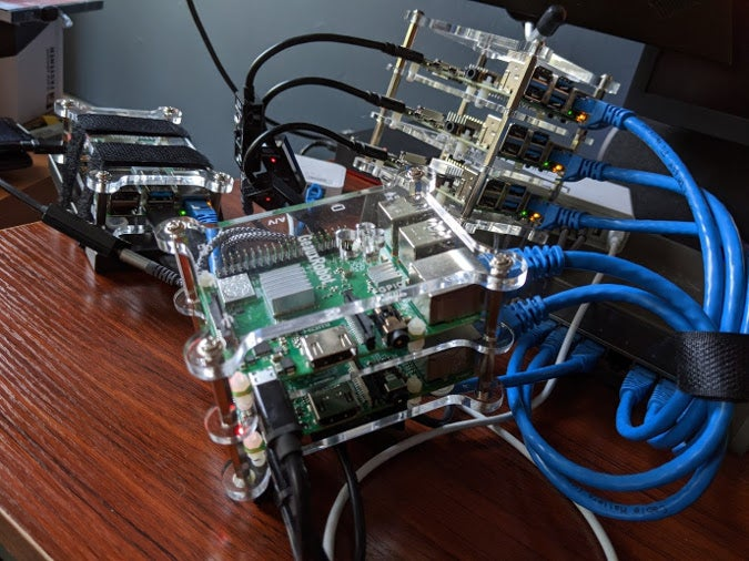 Raspberry Pis stacked up in cluster cases